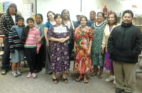 A group of Marshallese advocates from the Auburn area, including Jiji Jally (fourth from the left) and Almi Juano (second from the right) gather for a meeting. Photo credit: Children's Alliance.