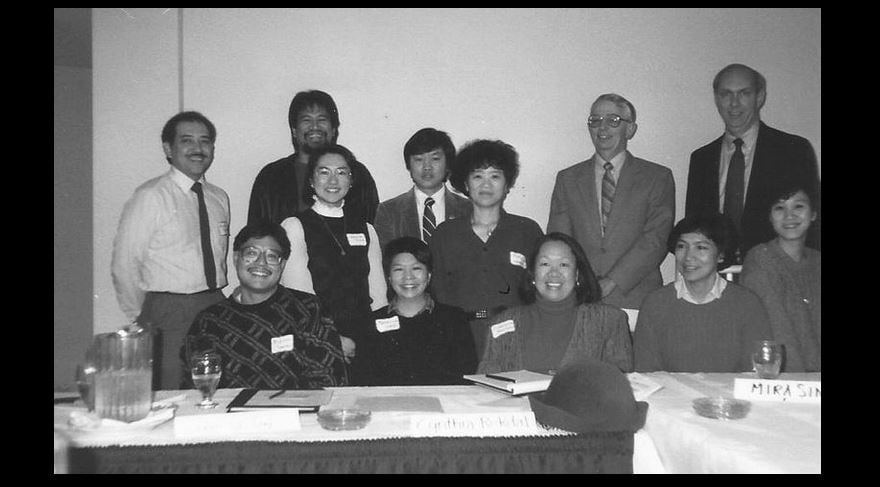 Commissioner Vang Xiong (third row center) and Cynthia Rekdal (first row center) at a community meeting. • Courtesy Photo (undated)
