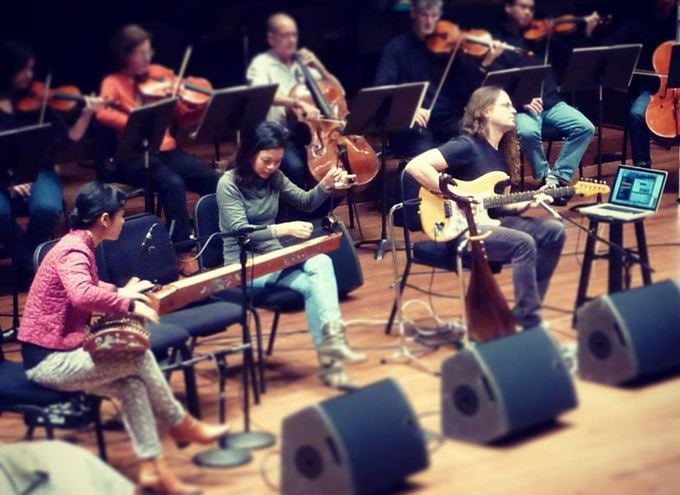 East-meets-West with a world premiere by Richard Karpen, featuring The Six Tones on traditional Vietnamese instruments and electric guitar. Rehearsal photo from Seattle Symphony Facebook page.