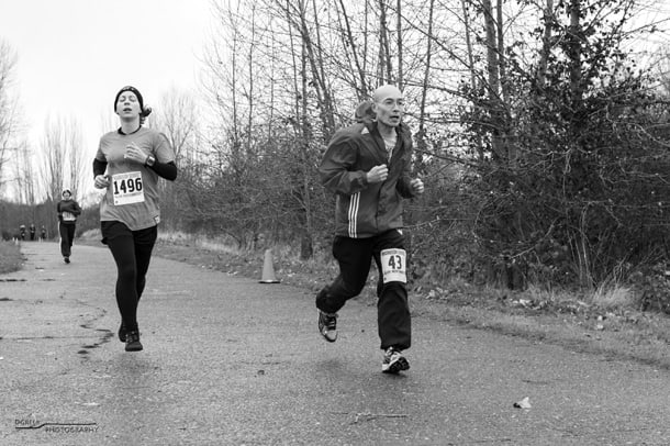 On a 5K race in South King County in 2013, Ron Chew leaves a younger racer in the dust. • Photo by Dave Greer