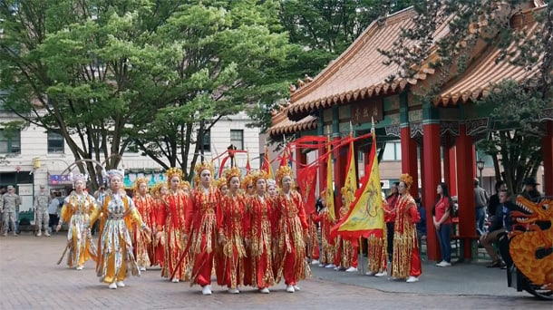 The Seattle Chinese Community Girls Drill Team performs at the Hing Hay Park ceremony. • Photo by Tuyen Kim Than