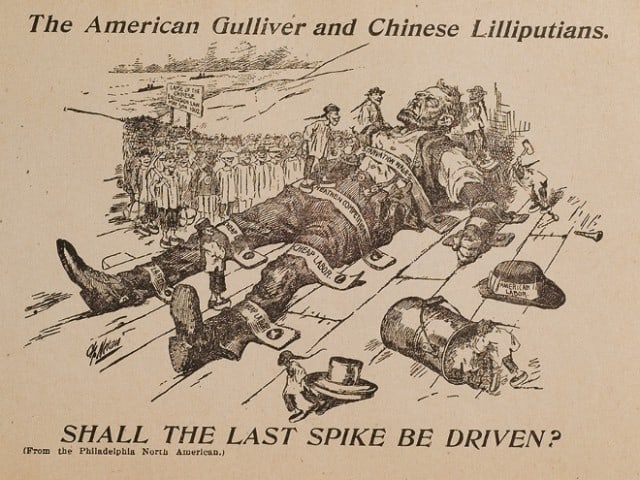 "In this image from the American Federation of Labor in 1902, American labor travels like Gulliver to expand his possibilities only to be tied down by a horde of tiny men wielding railroad spikes and cheap labor. ""The American Gulliver and Chinese Lilliputians."" Fales Library and Special Collections, New York University. • Image from Yellow Peril! An Archive of Anti-Asian Fear"