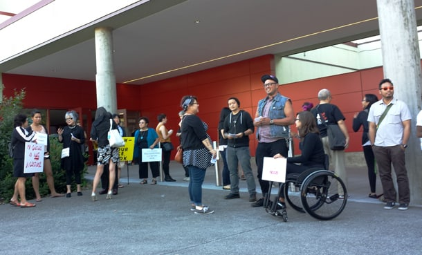 Protestors await the next showing of The Mikado in Seattle on Friday, July 25. • Photo by Jacqueline Wu