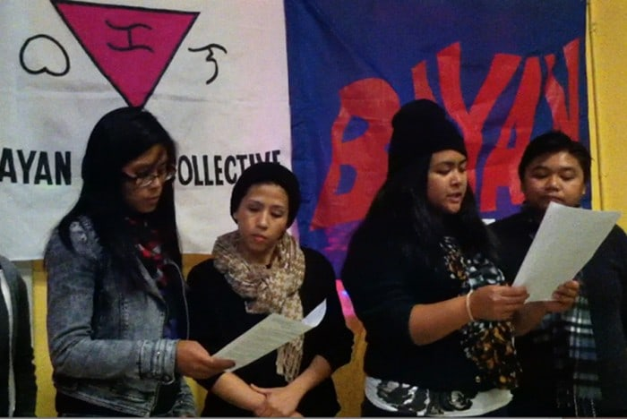 From left to right, Laurie Torres, Rosie Dino, Elaine Agoot and Jill Mangiliman read their letter in memory of Jennifer Laude to vigil attendees. • Photo by Christina Twu