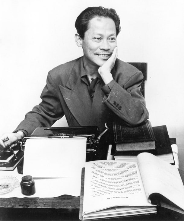 Bulosan at desk with typewriter, ca. 1950s. University of Washington Libraries, Special Collections, POR0020.