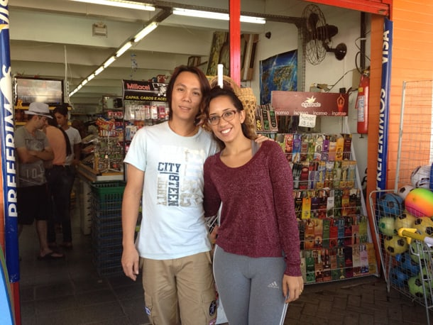 Husband and wife team Chen Wen Jun and Dyana da Silva Faustino run a corner store in Paraty, Brazil. • Photo by Nick Wong