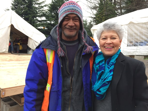 Herman Kahaloa at Nickelsville tent city with Alfie Avarado-Ramos, director of the Washington State Department Of Veteran Affairs. Kahaloa is a veteran. He has since moved into LIHI housing and has a job. • Courtesy Photo