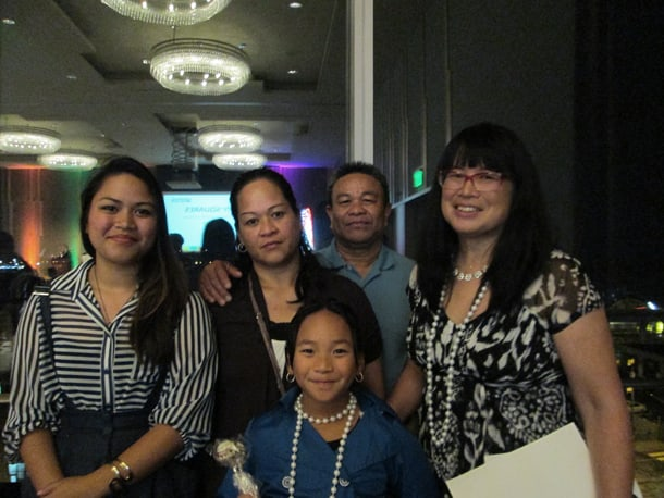 Dorcia Duenas (second from right), her husband, and two daughters were homeless and lived at Nickelsville for many months. They stayed in a tent in the middle of winter and the children attended school. They have since moved into LIHI housing and are doing very well. Also pictured, LIHI executive director Sharon Lee (right). • Courtesy Photo