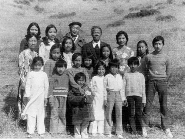 """May 1975, Camp Pendleton, CA. """"Our very first picture with some family members and some extended family members including paternal grandpa and the priest that ministered to refugees in the camp,"""" according to PhuongChi Nguyen. • Courtesy Photo"""