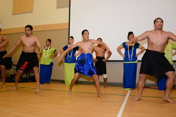 The NIU Roots and Ocean groups perform traditional Pacific Island songs and dances in front of a full audience in the ACRS gym between films. • Photo courtesy of ACRS