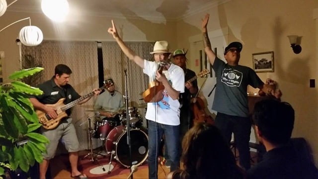 Daniel Pak (center) of Kore Ionz and Geo Quibuyen of Blue Scholars at an ACRS Walk for Rice benefit house party on June 12. Theory of Change, with David Hiller on bass, Ben Henry on guitar, Justin Chan on cello, and Lui Williams on drums, plays with them. Pak and Geo will kick up the fun at the Rally for Social Security's 80th & Medicare's 50th Birthdays!, August 8, 2015 1:00 p.m. to 3:00 p.m. at the  Westlake Park. • Photo by Candace Inagi
