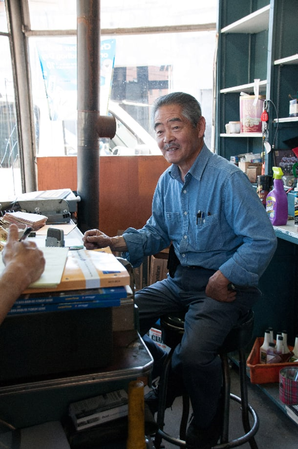 Seventh Avenue Service owner Pat Abe in his office. • Photo by  Walt Tuai