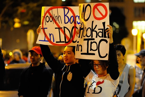 Protestors hold signs against hookah bars in the International District at a rally and march on July 24, 2015. • Photo by Isaac Liu