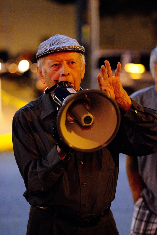Uncle Bob Santos on a bullhorn at the July 31 nonviolent protest against hookah bars. • Photo by Isaac Liu