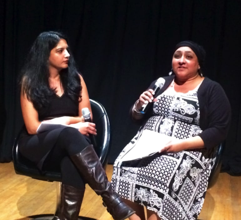 """KCTS 9's Laila Kazmi (left) speaks with Festival Director Kiran Dhillon about SSAFF's films, events, and its tenth anniversary theme, """"Coming Home."""" SSAFF's 2015 films represent 9 countries, and will screen in 5 cities across Greater Seattle. • Photo by Lexi Potter"""