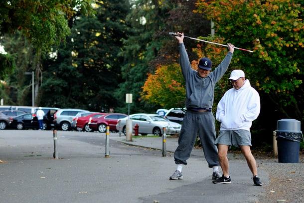Al Sugiyama and Tim Tsubahara stretch for their next run at Seward Park. • Photo by Isaac Liu