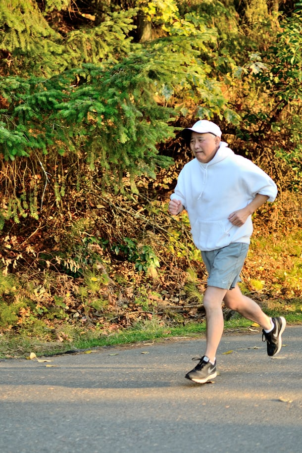 """""""I only started running again about three months ago,"""" Al Sugiyama said. """"What I'm trying to do is not give in to the fatigue caused by the chemotherapy and to build up a little strength."""" • Photo by Isaac Liu"""