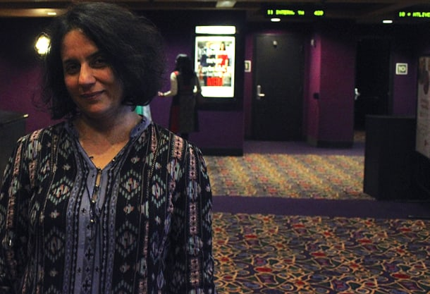 Festival Co-Director Dr. Alka Kurian awaits the crowd in the lobby of AMC Pacific Place in Seattle • Photo by Olivia Fuller