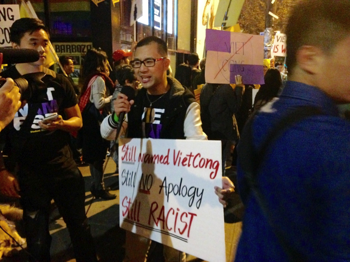 A picketer explains in front of a camera why the group is attempting to shut down Viet Cong. •  Photo by Seungkyul Park