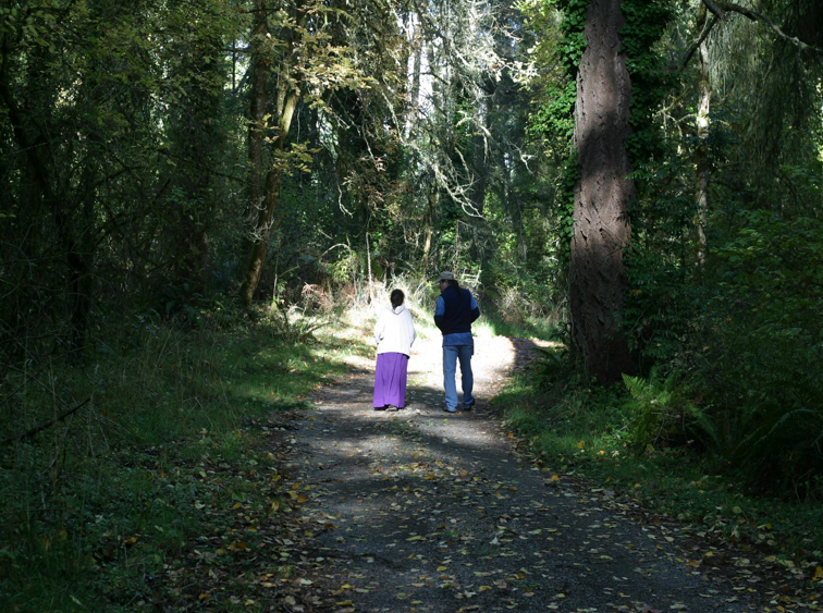 Path to the ceremonial grounds, escorted by Counsel Elder Jacque Martinson. • Photo by Joseph Denton