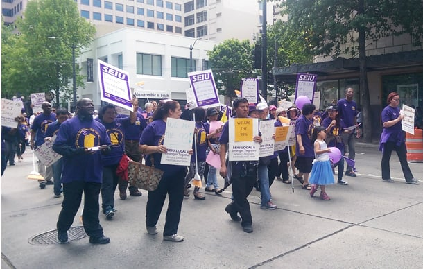 Unionized janitors and their supporters march downtown on May 13, 2016 to raise awareness of their working conditions as SEIU local 6, Seattle's janitor union, entered negotiations for a new contract in early June. • Photo by Izumi Hansen