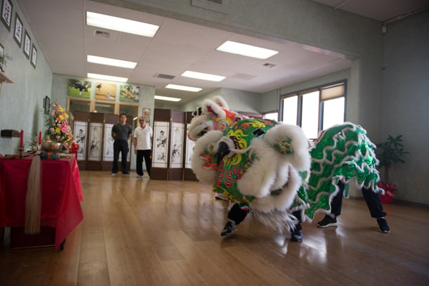 A visiting school performs a lion dance to bless the reopening of the International Wudang Internal Martial Arts Academy. • Photo by Nick Wong